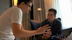 Edward Snowden (left) shows journalist Glenn Greenwald (right) how the encryption system works before sharing his leaked documents. Image via Spoilpolis.com.