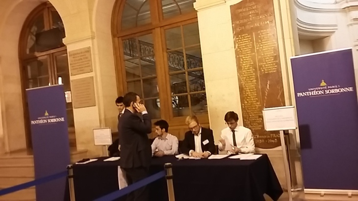Voluntary students check attendees' registrations before letting us in